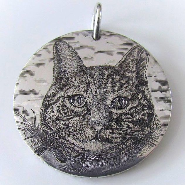 Hand engraved cat portrait on a handmade sterling silver pendant